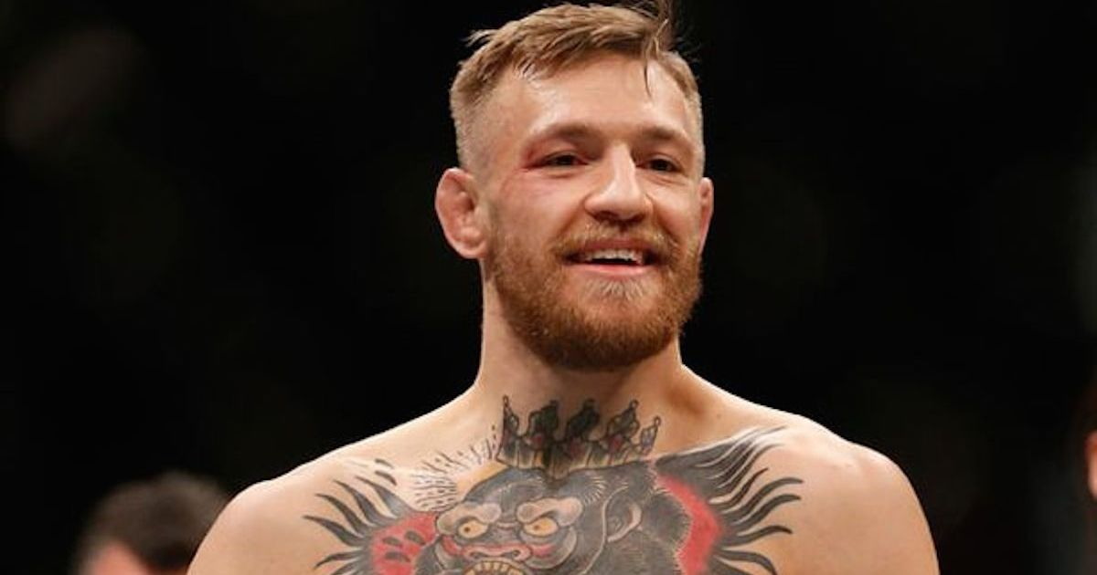 Conor-McGregor-of-Ireland-reacts-to-his-victory-over-Jose-Aldo-of-Brazil-in-their-UFC-featherweight-championship-bout