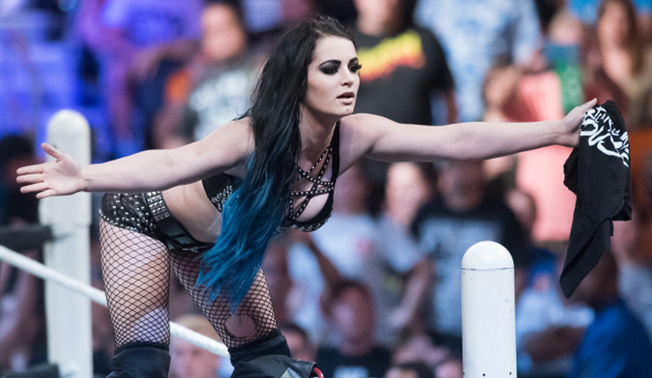 paige-stands-in-her-house-within-the-wwe-ring